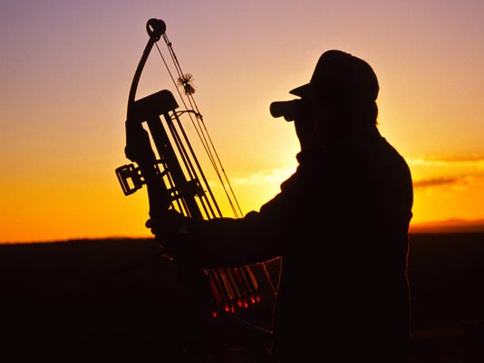 Bowhunter Glassing in Sunset