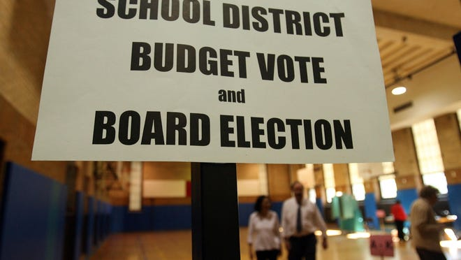 Most school districts in New York must get their budget plans passed at the polls. Signs direct voters at Highlands Middle School in White Plains during the 2009 vote.