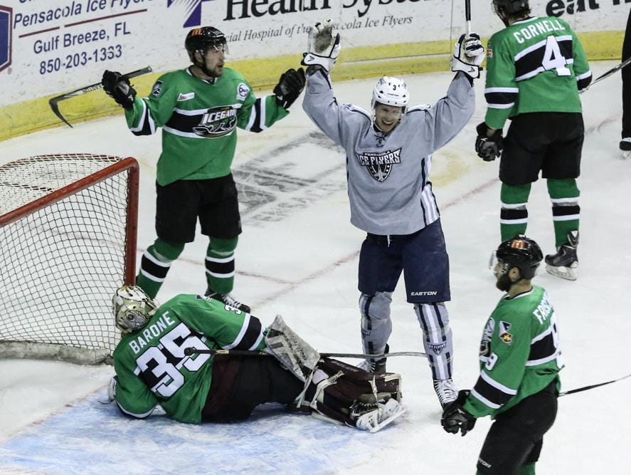 Ryan Kesti of the Ice Flyers reacts after beating IceGators goalie, Brad Barone, during Friday night's game at the Pensacola Bay Center.