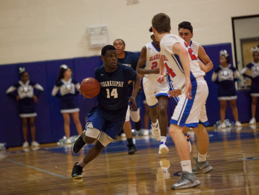 Poughkeepsie's Tremell Reaves drives against the Goshen defense during the Section 9 Class A final on March 5.