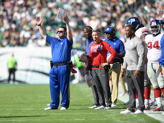New York Giants head coach Ben McAdoo, far left, reacts after there is no pass interference call on Odell Beckham Jr.'s defenders in the second half. Philadelphia Eagles defeated the New York Giants 27-24 in Philadelphia, PA on Sunday, September 24, 2017.