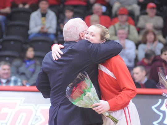 Stormville's Maggie Gallagher receives a hug from Marist women's basketball coach Brian Giorgis during the Senior Day ceremony in February 2015. Gallagher is now an assistant for Giorgis.