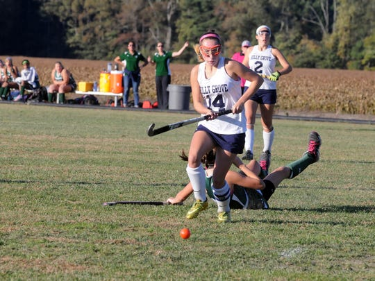 Holly Grove Foward Kelly Bundick (14) chases after a loose ball during an Eastern Shore Independent Athletic Conference field hockey playoff game on Wednesday, Oct. 21, 2015 versus Gunston Day School. Holly Grove won the game 2-0.