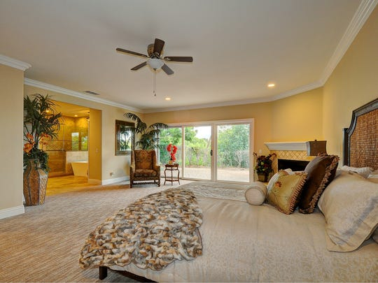 The master bedroom has a walk-in closet with built-ins and opens out to the master bathroom, which has warm wood cabinetry, double sinks, an extra-large shower and soaking tub with a glorious private view.