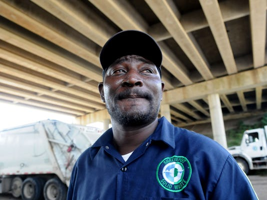 636203792343183667-SHR-0908-Garbage-Workers-pay1.JPG