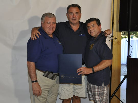 Assemblyman Anthony Bucco and Senator Tony Bucco with Daytop's President and CEO Jim Curtin after presenting him with a proclamation.