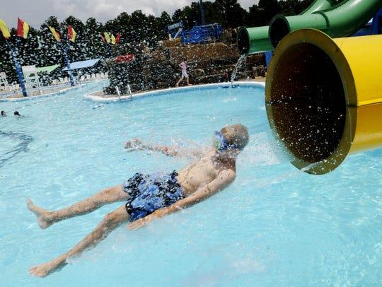 People having fun at Splash Kingdom Water Town on West