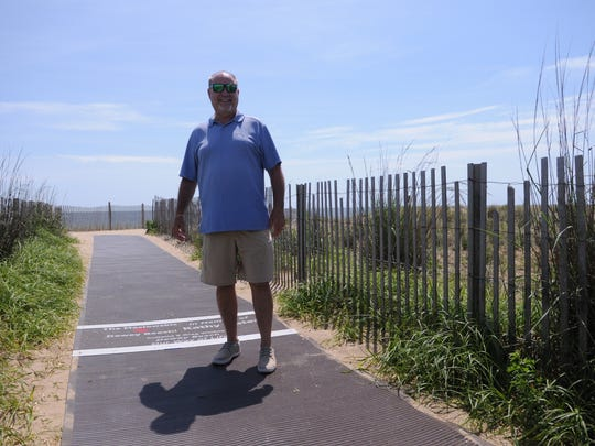 Commissioner Paul Bauer stands on the dune mat on Bellevue Street in Dewey Beach.