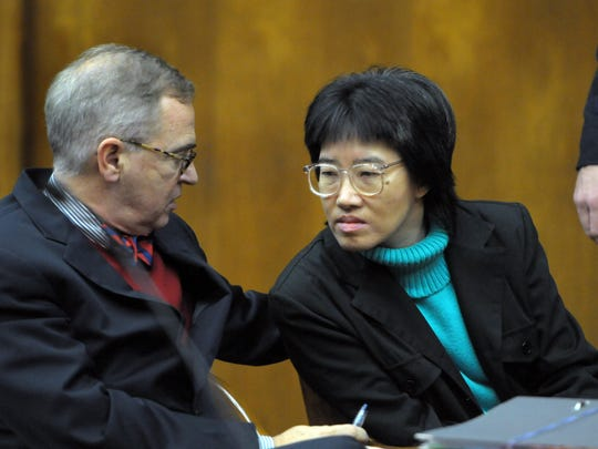89725 --- Hackensack --- December 6, 2011 --- Attorney Brian Neary consults with his client Jenny Tran during her murder trial. Tran is on trial for killing her ailing husband, Ming Trung Tran in 2009. AMY NEWMAN/STAFF PHOTOGRAPHER