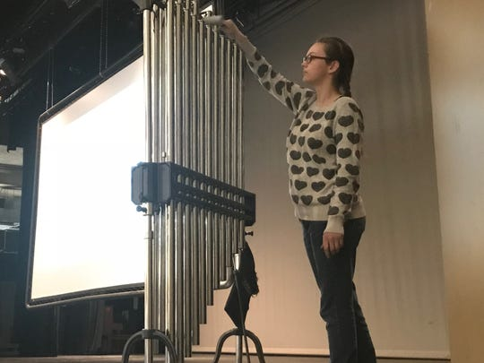 Rheannon Mathis, an Abilene High School sophomore, rings a chime 141 times during a student-organized assembly Friday. Mathis said the chime rang once for each life lost to gun-related school violence since April 20, 1999, when the Columbine High School shooting occurred.
