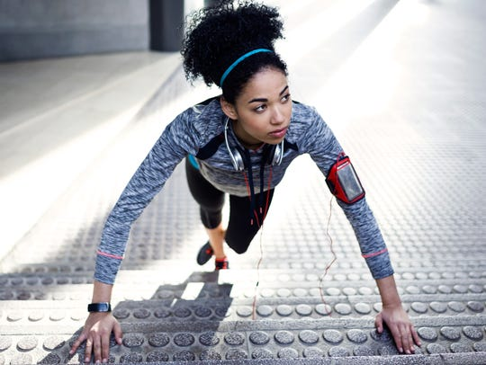 Portrait of fit and sporty young woman doing stretching
