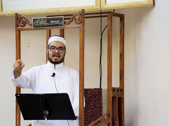 Imam Muhammad Nour leads in a sermon during a Friday prayer service on Aug. 4, 2017, at the Islamic Center of Naples.