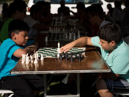 (left) Joshua Ona, 9, and Pierre Solorzano, 10, play chess during a chess tournament at the Passaic County Fair on Saturday, August, 19, 2017.