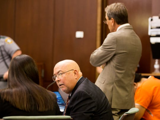 Lawyers for the defense and prosecution make final preparations for the September trial at the Collier County Courthouse Friday, Aug. 25, 2017, in Naples. Mesac Damas, despite claiming he wished to represent himself and plead guilty for the entirety of the case, refused to speak during the hearing.