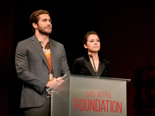 Jake Gyllenhaal (L) and Tatiana Maslany applaud onstage during the SAG-AFTRA Foundation Patron of the Artists Awards 2017 at the Wallis Annenberg Center for the Performing Arts on November 9, 2017 in Beverly Hills, California.