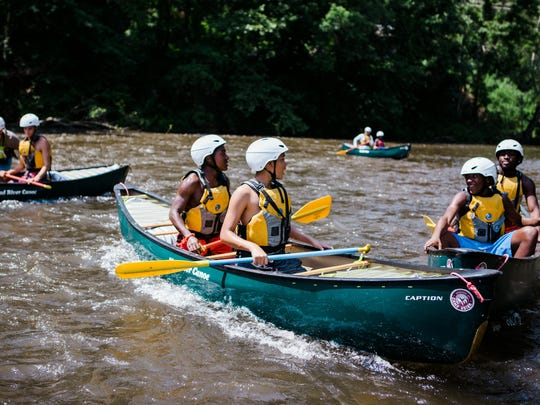Asheville kids learn to canoe at Camp Grier through the Streets to Peaks program. The Mountain Sports Festival this year serves as a fundraiser for Streets to Peaks, a Maybin Mission program.