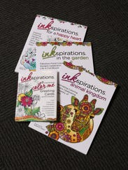 A series of Ink Inspirations adult coloring books,
