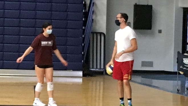 Josh Schmitz, right, is Hayden's new head volleyball coach after coaching the Wildcats' junior varsity a year ago.