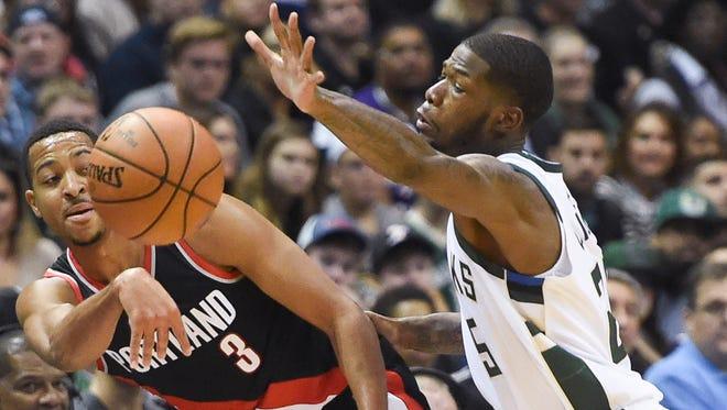 Journeyman guard DeAndre Liggins pressures Trail Blazers guard C.J. McCollum in Liggins' Bucks debut Saturday night.