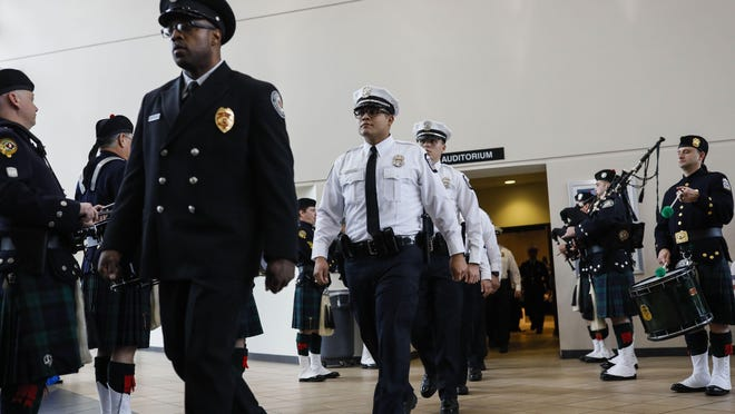 New Columbus police officers exit the auditorium at the Chief James G. Jackson Columbus Police Academy to mark the conclusion of graduation ceremonies for the 132nd recruit class on Friday, January 3, 2020.