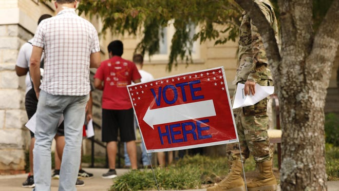 Advance voters wait in line at City Hall in downtown Athens on Oct. 21.