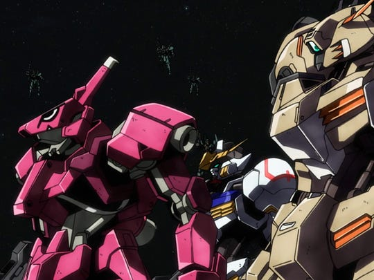 The Ryusei-Go, Gundam Barbatos and Gusion Rebake assume the victory formation. Well, sort of.