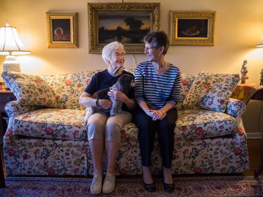 Lydia Kruesi, 95, left, sits with her dog Maggie and