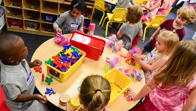 Preschoolers have fun playing on Tuesday, September 6, 2016, during the first day of preschool at Terrace Elementary School.