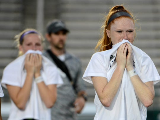Gulf Breeze players Sawyer Rowe and Katelyn Stahl react to their 3-2 (3-1 PKs) loss to Merritt Island in the Class 3A girls state soccer final.