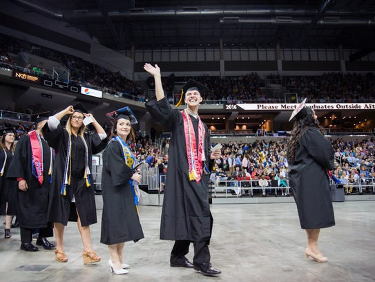 Nathan Doninger, magna cum laude, waves to his family