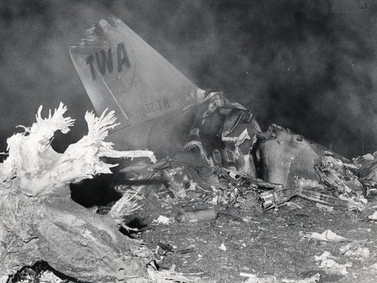 The tail of a TWA jet remains in the wreckage of Flight