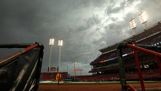 Dark clouds roll over the field during a rain delay prior to Monday's first pitch between the Cincinnati Reds and the Atlanta Braves at Great American Ball Park.