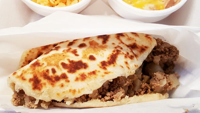 Gorditas made with a flour tortilla shell, stuffed with meat and potatoes ($3.99). Add a side of rice and beans at additional cost to make it a meal.