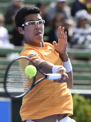 Chung Hyeon of South Korea return a shot against Nicolas Almagro of Spain during their men's singles match on day three at the Kooyong Classic tennis tournament in Melbourne this week.