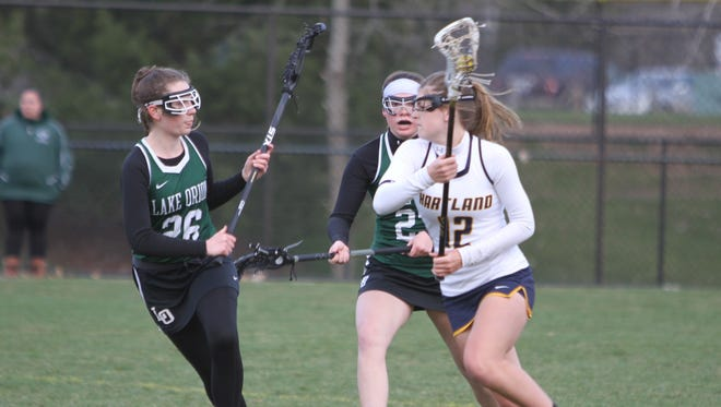 Hartland's Emily Beazley (12) scored four goals in a 15-9 victory over Northville.