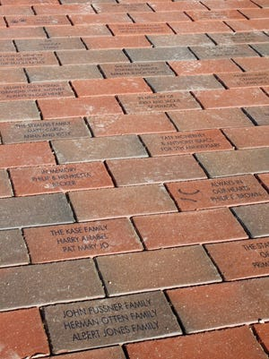 Price Hill Will and the St. Lawrence Square Committee conducted a brick paver campaign to help raise money for the neighborhood's new park space. Engraved bricks line the square's walkway.