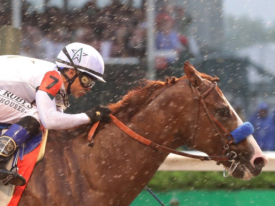 Justify, ridden by Mike Smith, wins the 144th Kentucky