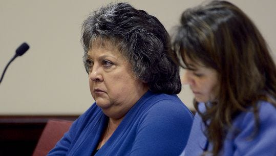 Former New Mexico Secretary of State Dianna Duran, left, sits with her attorney Erlinda Johnson in District Judge Glenn Ellington's court on Oct. 23 in Santa Fe.