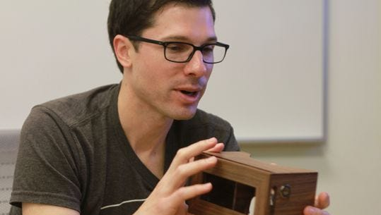 Clay Bavor, shown here with a wooden version of Google Cardboard, is leading the company's virtual reality efforts.