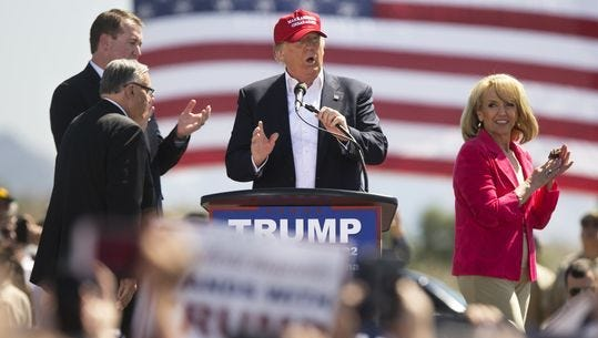 Trump, at a March 2016 rally in Fountain Hills with state Treasurer Jeff DeWit, then-Sheriff Joe Arpaio and former Gov. Jan Brewer.