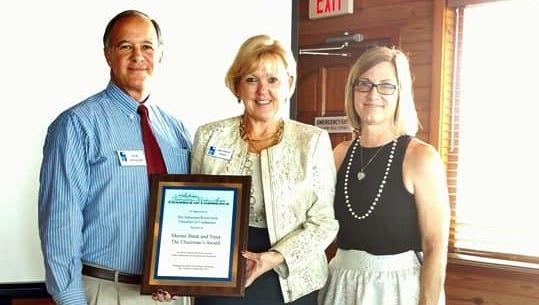 Marine Bank's Bob Morgan and Georgia Irish accept the Sebastian River Area Chamber's 2017 Chairman award from chamber chairwoman Dawn Biehl.