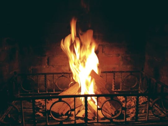 Use a fireplace screen. It takes one ember popping