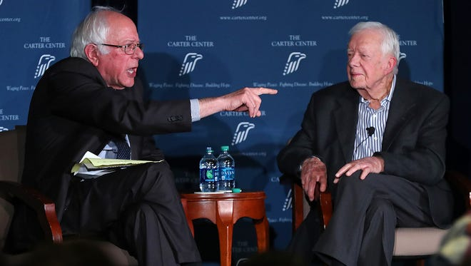 Former President Jimmy Carter and Sen. Bernie Sanders, I-Vt., discuss human rights during the Human Rights Defenders Forum at the Carter Center on Monday,