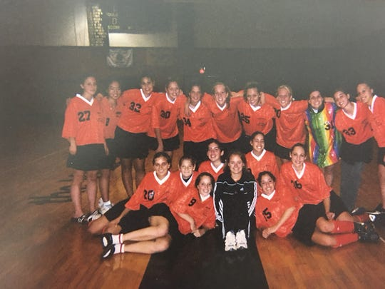 Meghan (seated, far right) with the Somerville High School field hockey team in 2004. Her number, 36, has been retired.