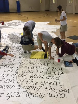 """Students work on sets for the production of """"The Lion, the Witch and the Wardrobe."""""""