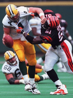 In what could and should have been a game breaking play Bengals linebacker Takeo Spikes sacks Packer quarterback Brett Favre on a fourth down play in the fourth quarter with 1:56 left in the game. The Bengals offense couldn't convert and the Packers took over on downs. The Bengals lost to the Green Bay Packers 13-6. Cincinnati Enquirer/Michael E. Keating mek