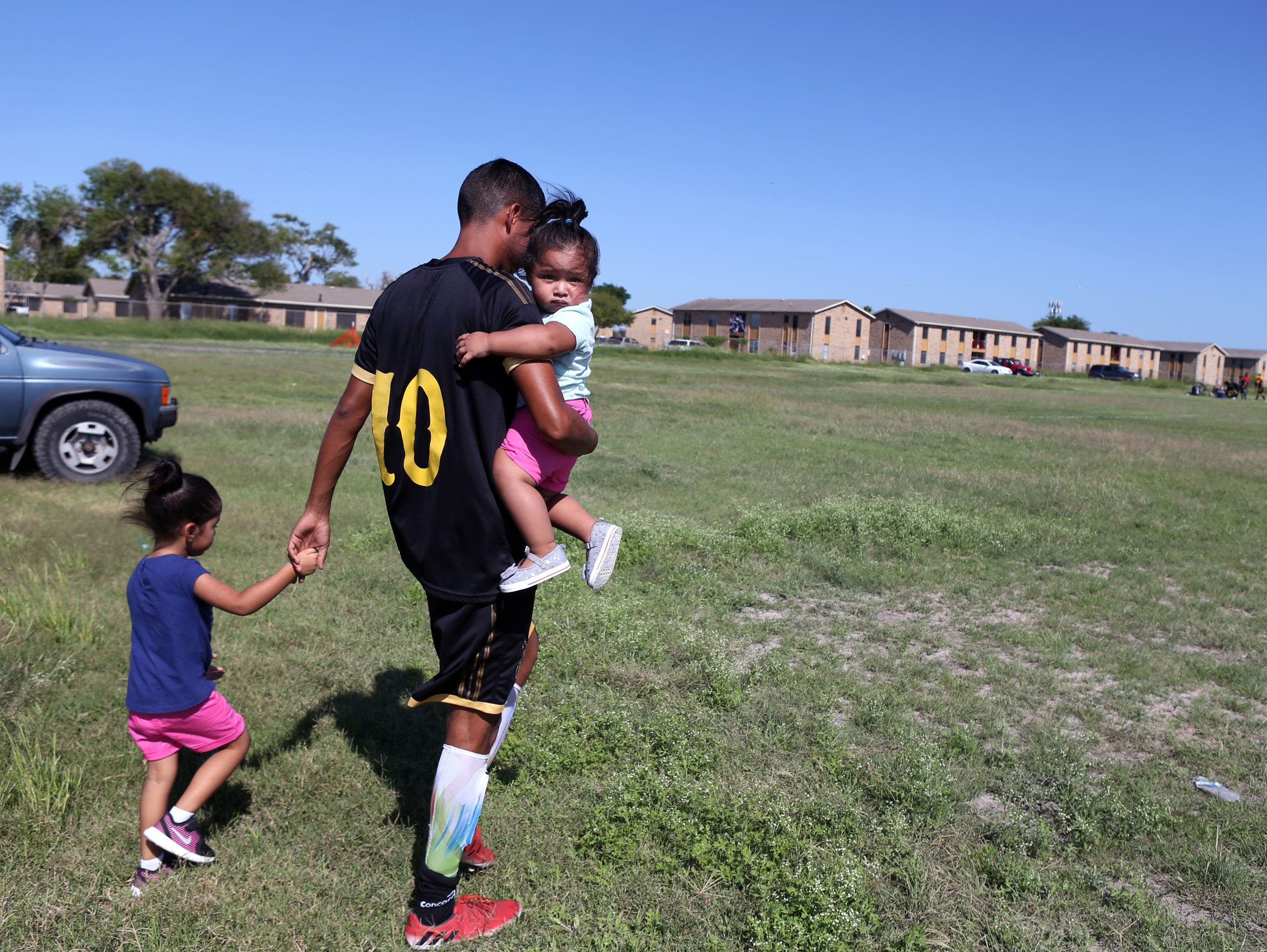 Former DACA recipient Ezequiel Rojas Martinez and his girls, Evalynn Rojas (left), 4 (Dec 5), and Nayeli Rojas, 1 1/2, head to the soccer field on Oct. 8, 2017. He's seeking legal permanent residency in the U.S.