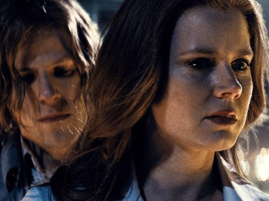 """This image released by Warner Bros. Pictures shows Jesse Eisenberg, left, and Amy Adams in a scene from, """"Batman v Superman: Dawn of Justice."""" (Warner Bros. Pictures via AP)"""