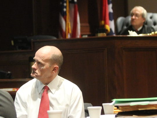 Lee Watts, left, and Judge Ross Hicks looks at a screen