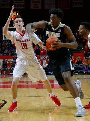 Rutgers Scarlet Knights guard Justin Goode (10) defends against Purdue Boilermakers forward Caleb Swanigan (50) during the first half at Louis Brown Athletic Center.